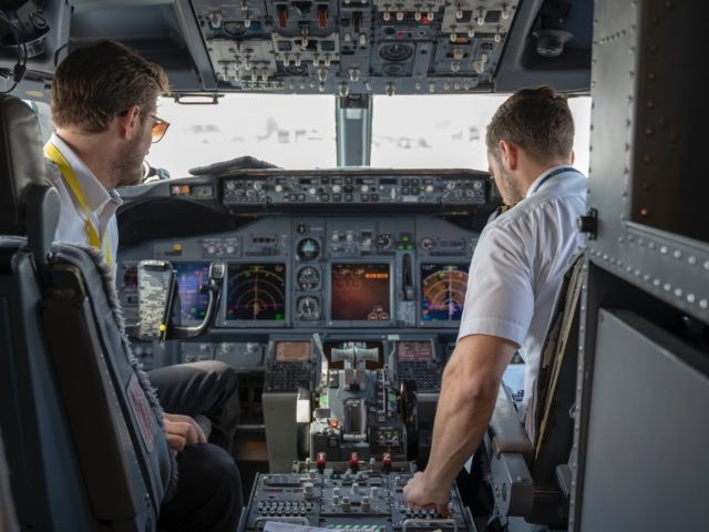 two pilots sitting inside plane
